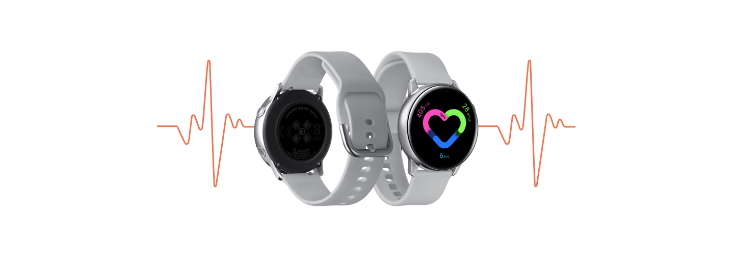 The silver Galaxy Watch Active seen from the back, next to an image of the front. On the watch face is a heart monitor visual. Behind the watch images is a thin red line of a heartbeat from an EKG.