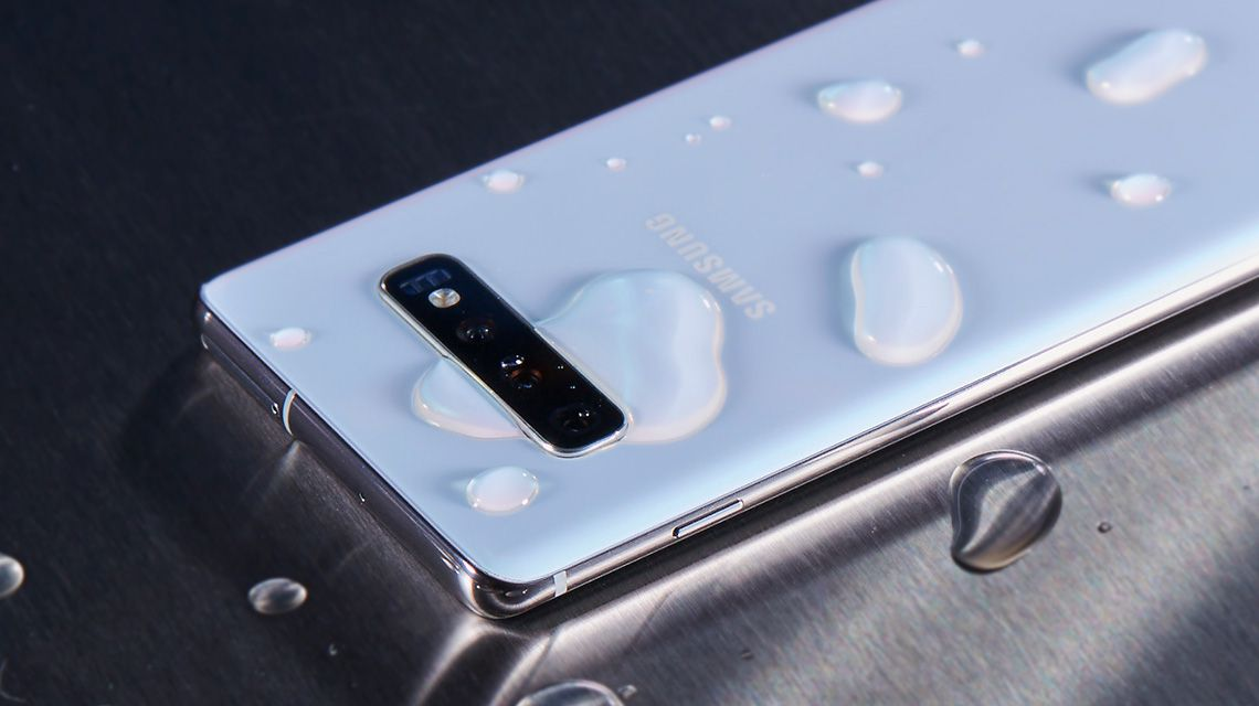 Samsung Galaxy S10 with IP68 Water and Dust Resistance - Glass Back on Table with Water Droplets