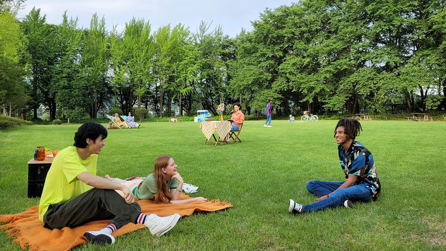 Photo of people sitting in a park, without any zoom.