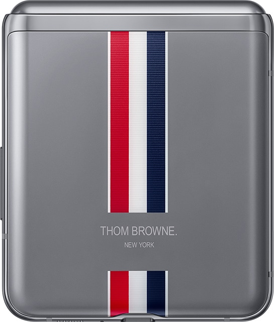 Galaxy Z Flip Thom Browne Edition seen folded with the signature Thom Browne stripes on the bottom of the phone