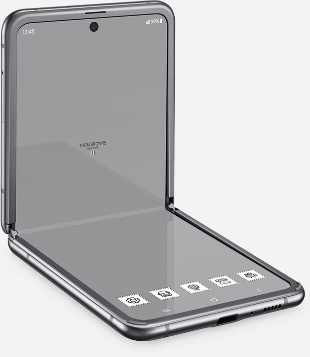 Galaxy Z Flip Thom Browne Edition seen at a three-quarter angle with the Thom Browne home screen onscreen